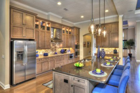 the gourmet kitchen includes a center island and sunny casual breakfast nook that seats six  the kitchen cabinetry features stacked upper glass door     sisler johnston design completes the biltmore ii at twenty mile  rh   icihomesinpontevedra com